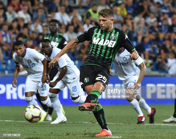 Domenico Berardi of US Sassuolo kicks the penalty and scores the opening goal during the Serie A match between US Sassuolo and FC Internazionale at...