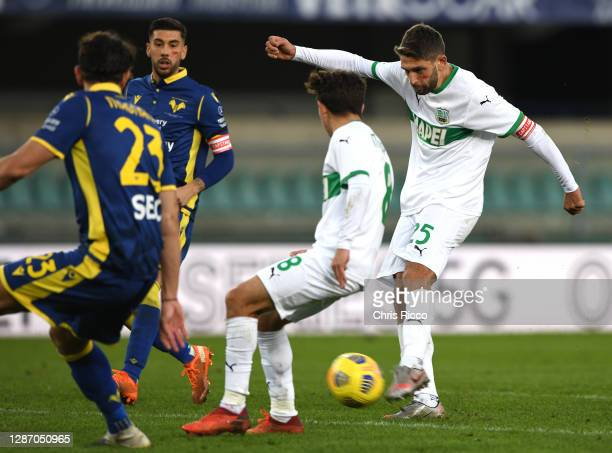 Domenico Berardi of US Sassuolo scores their sides second goal during the Serie A match between Hellas Verona FC and US Sassuolo at Stadio...