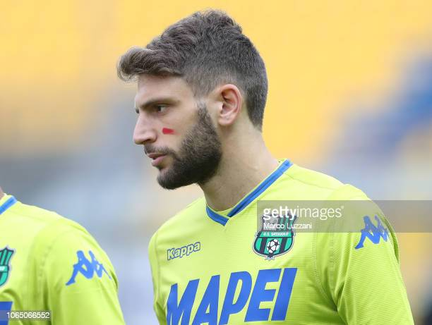 Domenico Berardi of US Sassuolo show the red mark on the face to support the campaign Un Rosso Alla Violenza before the Serie A match between Parma...