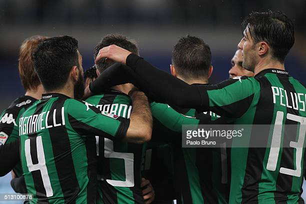 Domenico Berardi with his teammates of US Sassuolo celebrates after scoring the opening goal from penalty spot during the Serie A match between SS...