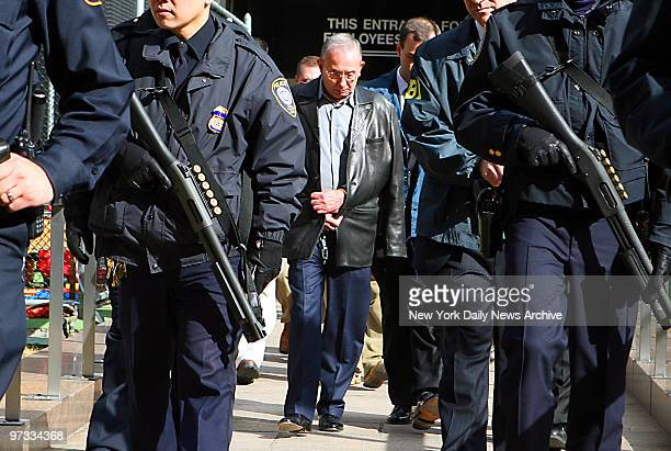 Domenico Cefalu is walked from the FBI's New York Field Office at 26 Federal Plaza behind a heavily armed police contingent after the arrests of more...