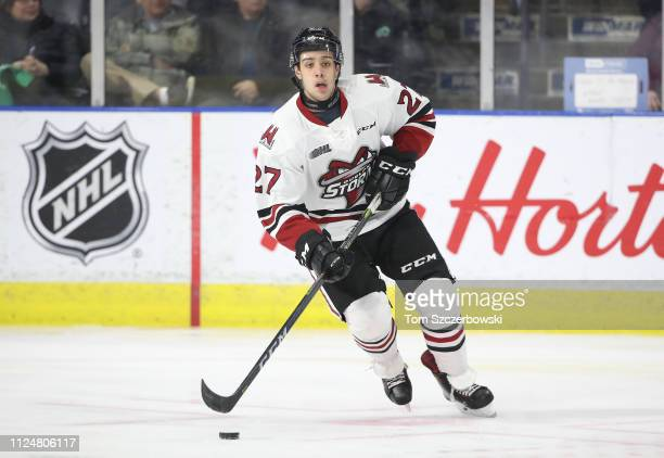 Domenico Commisso of the Guelph Storm skates with the puck in the first period during OHL game action against the London Knights at Budweiser Gardens...