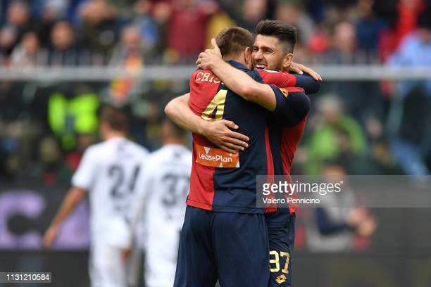 Domenico Criscito and Ervin Zukanovic of Genoa CFC celebrate victory at the end of the Serie A match between Genoa CFC and Juventus at Stadio Luigi...
