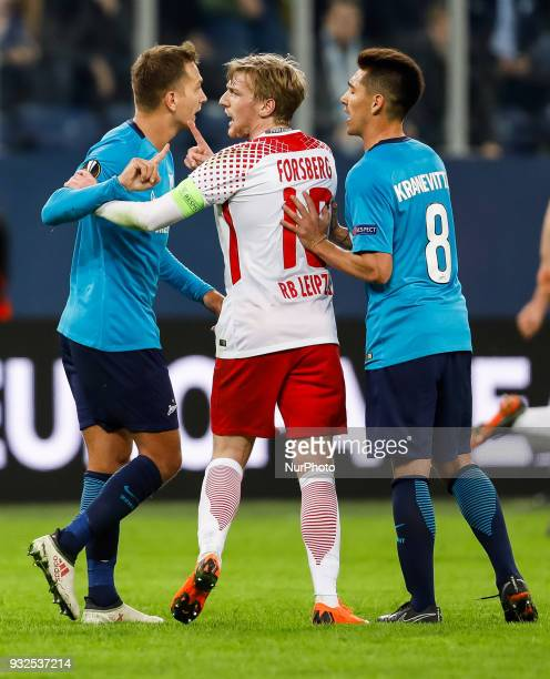 Domenico Criscito and Matias Kranevitter of FC Zenit Saint Petersburg argue with Emil Forsberg of RB Leipzig during the UEFA Europa League Round of...