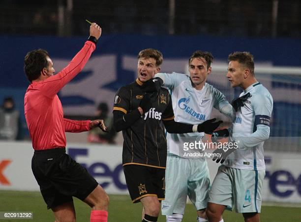 Domenico Criscito and Mauricio of Zenit SaintPetersburg in action against Ronan Finn of Dundalk FC during UEFA Europa League match between Zenit...