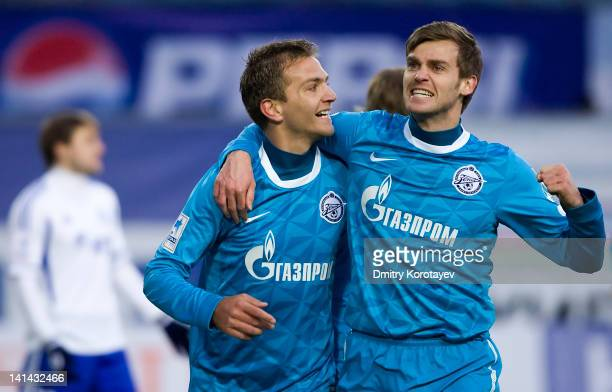 Domenico Criscito and Nicolas Lombaerts of FC Zenit St. Petersburg celebrate after scoring a goal during the Russian Football League Championship...
