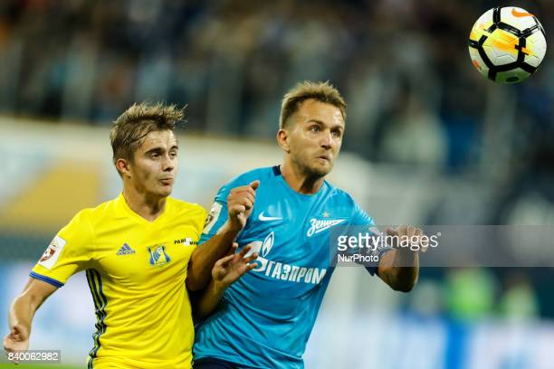 Domenico Criscito of FC Zenit Saint Petersburg and Aleksandr Zuyev of FC Rostov vie for the ball during the Russian Football League match between FC...