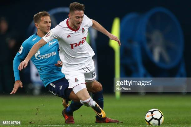 Domenico Criscito of FC Zenit Saint Petersburg and Anton Miranchuk of FC Lokomotiv Moskva vie for the ball during the Russian Football League match...