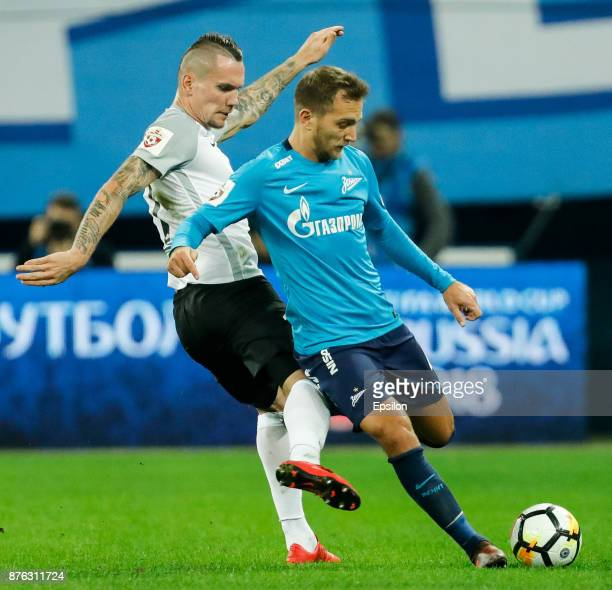 Domenico Criscito of FC Zenit Saint Petersburg and Anton Zabolotny of FC Tosno vie for the ball during the Russian Football League match between FC...