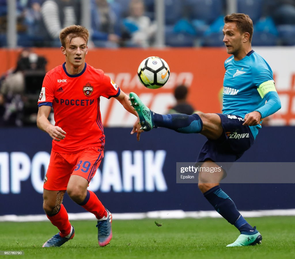 Domenico Criscito (R) of FC Zenit Saint Petersburg and Konstantin Kuchayev of PFC CSKA Moscow vie for the ball during the Russian Football League match between FC Zenit Saint Petersburg and PFC CSKA Moscow on April 29, 2018 at Saint Petersburg Stadium in Saint Petersburg, Russia.
