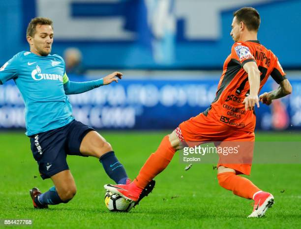 Domenico Criscito of FC Zenit Saint Petersburg and Nikolay Dimitrov of FC Ural Ekaterinburg vie for the ball during the Russian Football League match...