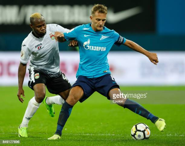 Domenico Criscito of FC Zenit Saint Petersburg and Sly of FC Ufa vie for the ball during the Russian Football League match between FC Zenit St...