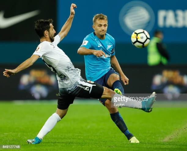 Domenico Criscito of FC Zenit Saint Petersburg passes the ball as Azamat Zaseyev of FC Ufa defends during the Russian Football League match between...