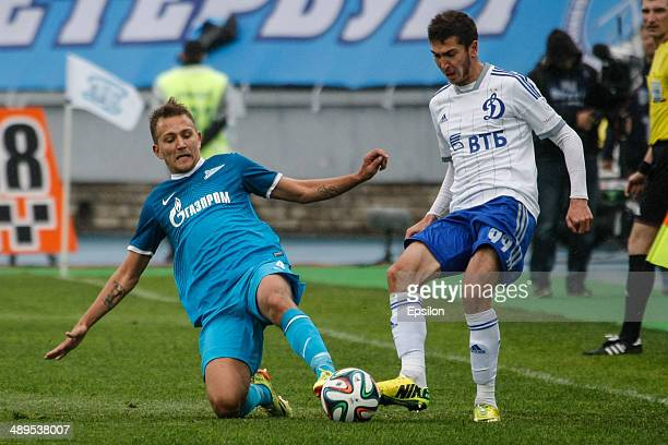 Domenico Criscito of FC Zenit St Petersburg and Aleksei Ionov of FC Dynamo Moscow vie for the ball during the Russian Football League Championship...