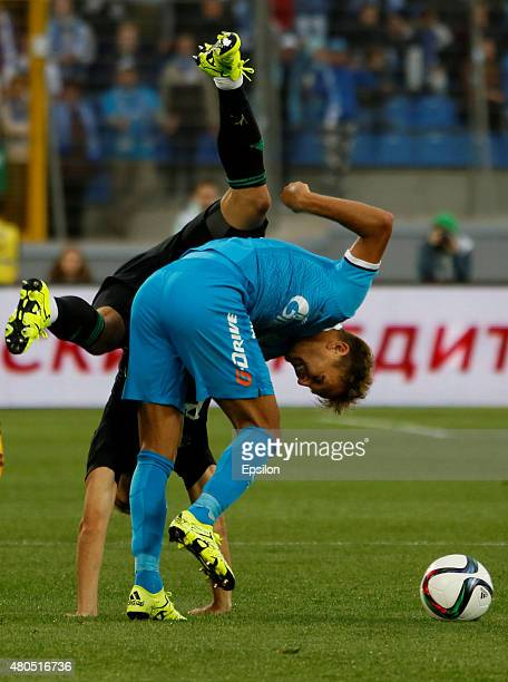Domenico Criscito of FC Zenit St Petersburg and Roman Shishkin of FC Lokomotiv Moscow vie for the ball during the Super Cup of Russia 2015 match...