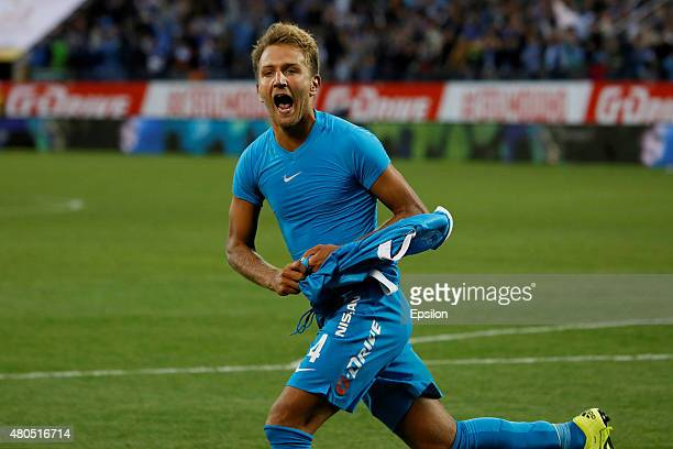 Domenico Criscito of FC Zenit St Petersburg celebrates scoring a decisive penalty shot during the Super Cup of Russia 2015 match between FC Zenit St...