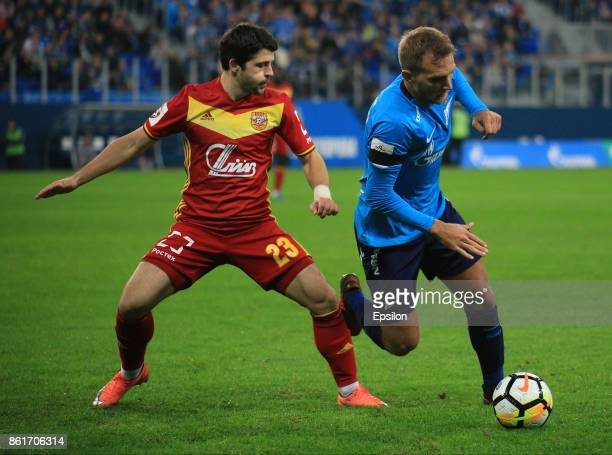 Domenico Criscito of FC Zenit St Petersburg vies for the ball with Igor Gorbatenko of FC Arsenal Tula during the during the Russian Premier League...