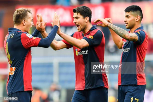 Domenico Criscito of Genoa celebrates with Ervin Zukanovic of Genoa and Cristian Romero of Genoa after the Serie A match between Genoa CFC and SS...