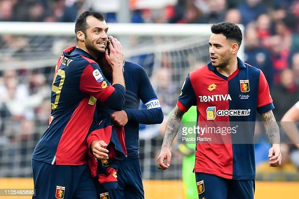 Domenico Criscito of Genoa celebrates with Goran Pandev of Genoa and Antonio Sanabria of Genoa after scoring a goal during the Serie A match between...