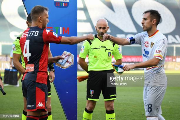 Domenico Criscito of Genoa CFC and Marco Mancosu of US Lecce before the Serie A match between Genoa CFC and US Lecce at Stadio Luigi Ferraris on July...