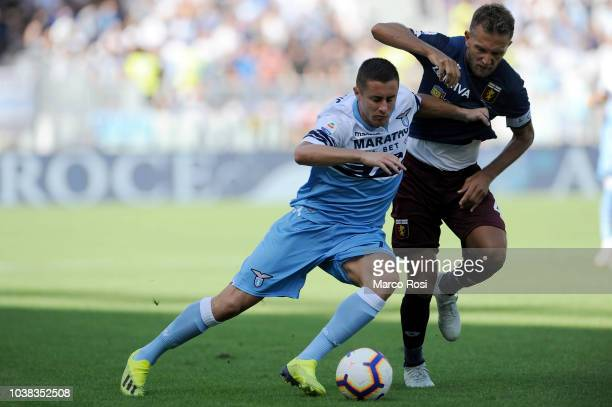 Domenico Criscito of Genoa CFC compete for the ball with Adam Marusic of SS Lazio during the serie A match between SS Lazio and Genoa CFC at Stadio...