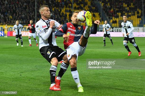 Domenico Criscito of Genoa CFC competes for the ball with Simone Iacoponi of Parma Calcio during the Serie A match between Parma Calcio and Genoa CFC...