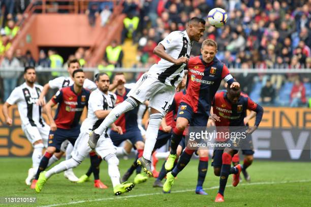 Domenico Criscito of Genoa CFC goes up with Alex Sandro of Juventus during the Serie A match between Genoa CFC and Juventus at Stadio Luigi Ferraris...