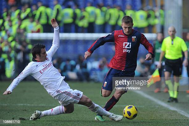 Domenico Criscito of Genoa CFC is challenged by Massimo Oddo of AC Milan during the Serie A match between Genoa CFC and AC Milan at Stadio Luigi...
