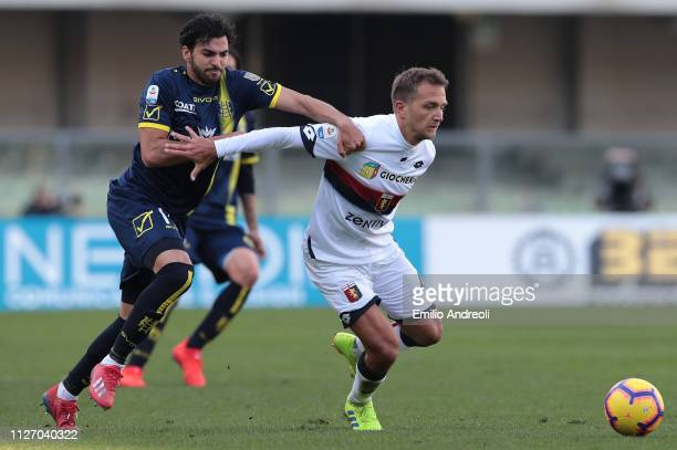 Domenico Criscito of Genoa CFC is challenged by Mehdi Leris of Chievo Verona during the Serie A match between Chievo Verona and Genoa CFC at Stadio...
