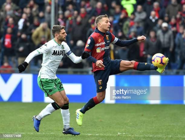 Domenico Criscito of Genoa CFC oppose to Domenico Berardi of US Sassuolo during the Serie A match between Genoa CFC and US Sassuolo at Stadio Luigi...