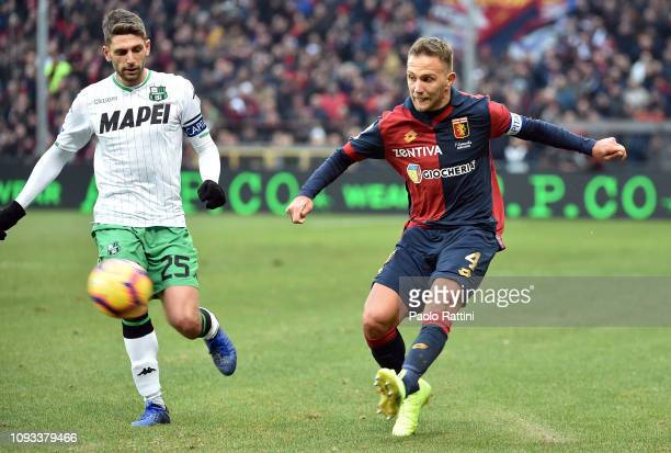 Domenico Criscito of Genoa CFC opposed to Domenico Berardi of US Sassuolo during the Serie A match between Genoa CFC and US Sassuolo at Stadio Luigi...
