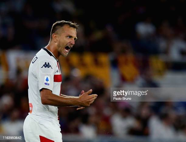 Domenico Criscito of Genoa CFC reacts after scoring the team's second goal from penalty spot during the Serie A match between AS Roma and Genoa CFC...