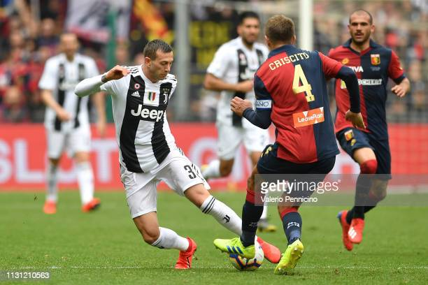 Domenico Criscito of Genoa CFC tackles Federico Bernardeschi of Juventus during the Serie A match between Genoa CFC and Juventus at Stadio Luigi...
