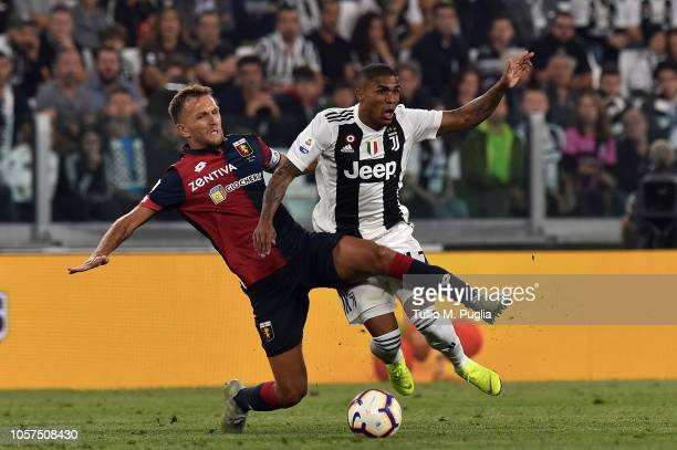 Domenico Criscito of Genoa fouls Douglas Costa of Juventus during the Serie A match between Juventus and Genoa CFC at Allianz Stadium on October 20...