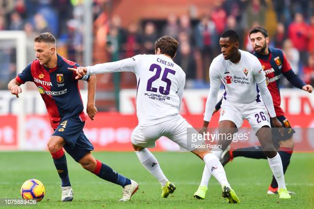 Domenico Criscito of Genoa runs away from Federico Chiesa and Edmilson Fernandes of Fiorentina during the Serie A match between Genoa CFC and ACF...