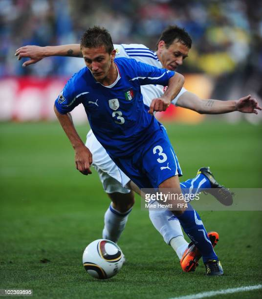 Domenico Criscito of Italy is challenged by Zdenko Strba of Slovakia during the 2010 FIFA World Cup South Africa Group F match between Slovakia and...