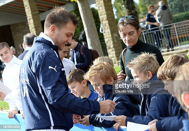 Domenico Criscito of Italy sign autographs for fan after a training session at Coverciano on November 13 2013 in Florence Italy