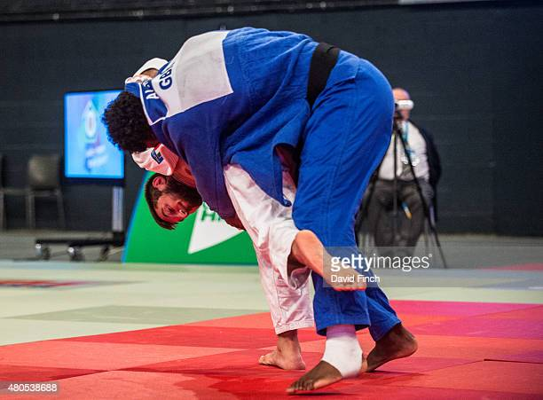 Domenico Di Guida of Italy throws Philip AwitiAlcaraz also of Great Britain for an ippon to win the u100kg gold medal during the 2015 London European...