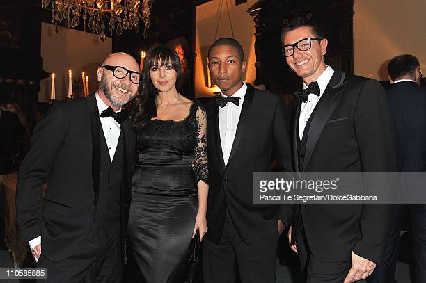 Domenico Dolce Monica Bellucci Pharrell Williams and Stefano Gabbana attend the DolceGabbana and Martini gold dinner at the Italian Ambassador...