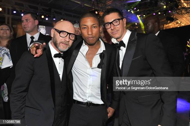 Domenico Dolce Pharrell Williams and Stefano Gabbana attend the DolceGabbana and Martini gold Dance Art Garage party on March 17 2011 in Moscow Russia