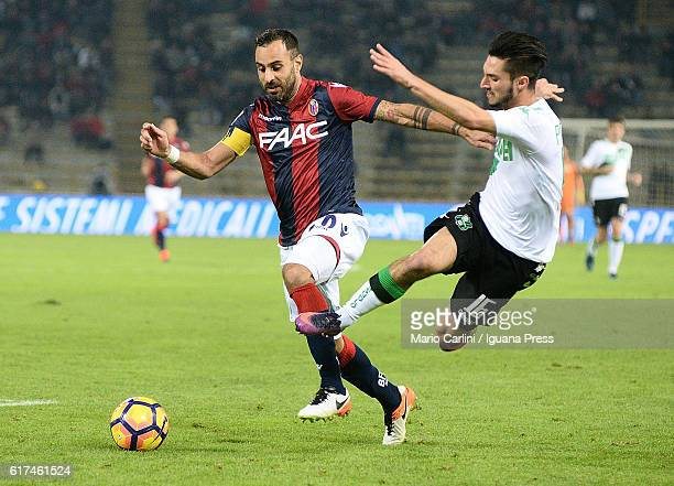 Domenico Maietta of Bologna FC competes the ball with Matteo Politano of US Sassuolo during the Serie A match between Bologna FC and US Sassuolo at...