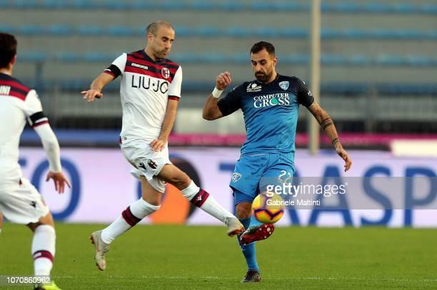 Domenico Maietta of Empoli FC in action against Rodrigo Palacio of Bologna FC during the Serie A match between Empoli and Bologna FC at Stadio Carlo...