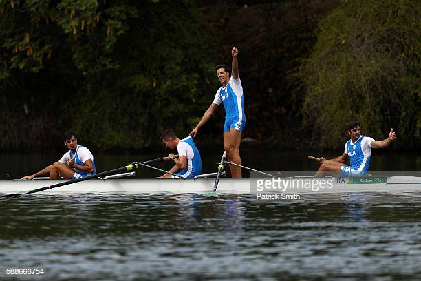 Domenico Montrone Matteo Castaldo Matteo Lodo and Giuseppe Vicino of Italy celebrate winning the bronze medal after the Men's Four Final A on Day 7...