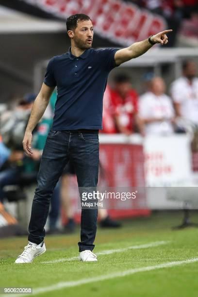 Domenico Tedesco coach of Schalke reacts during the Bundesliga match between 1 FC Koeln and FC Schalke 04 at RheinEnergieStadion on April 22 2018 in...