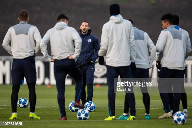 Domenico Tedesco, Head Coach of FC Schalke 04 talks to the players during a training prior to the Group D match of the UEFA Champions League between...