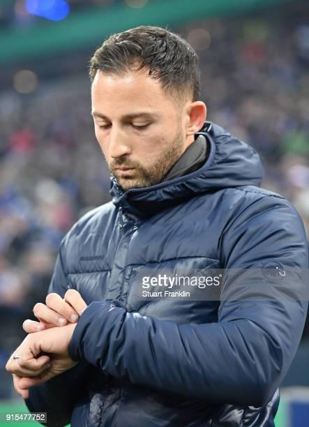 Domenico Tedesco head coach of Schalke checks his watch during the DFB Pokal quarter final match between FC Schalke 04 and VfL Wolfsburg at...