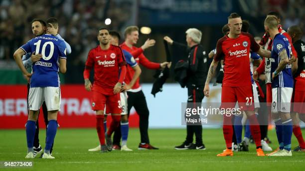Domenico Tedesco, head coach of Schalke comforts Nabil Bentaleb after the Bundesliga match between FC Schalke 04 and Eintracht Frankfurt at...