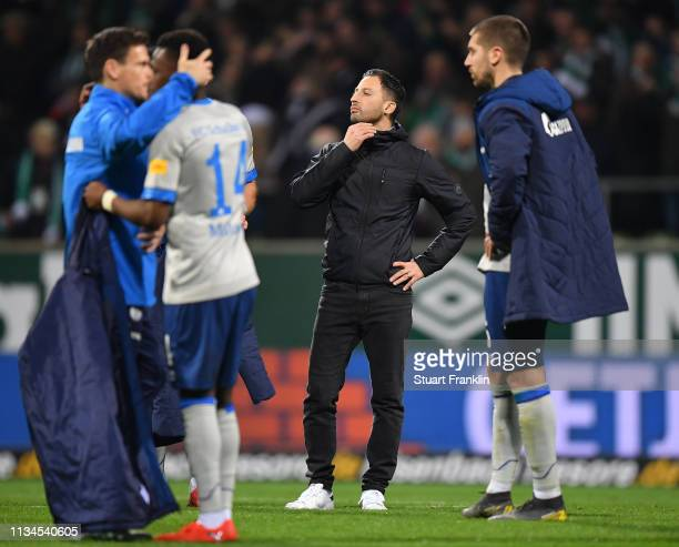 Domenico Tedesco, head coach of Schalke holds his throat as he ponders at the end of the Bundesliga match between SV Werder Bremen and FC Schalke 04...