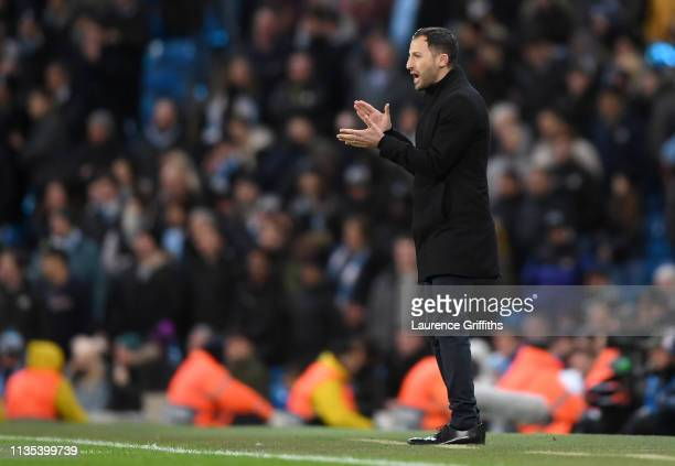 Domenico Tedesco, Manager of FC Schalke 04 gives his team instructions during the UEFA Champions League Round of 16 Second Leg match between...