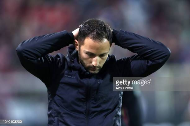 Domenico Tedesco Manager of FC Schalke 04 reacts after Florian Niederlechner of Freiburg scored their side's first goal during the Bundesliga match...